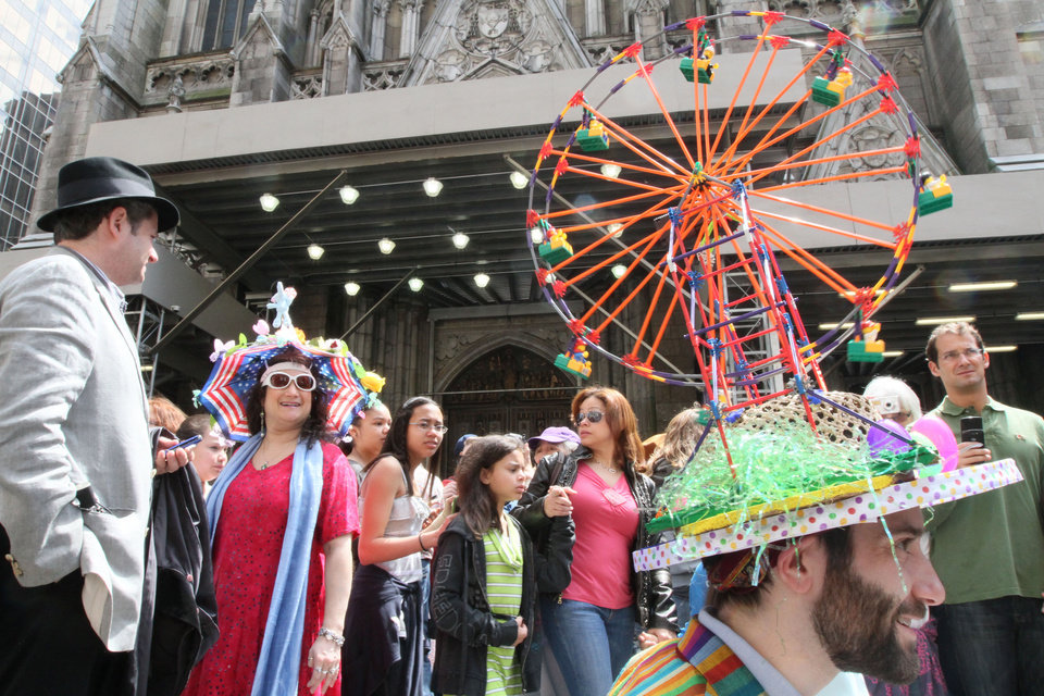 Photo -   Wearing a ferris wheel hat, Mike Revenaugh, of the Queens borough of New York, right, poses for photographers as he and others take part in the Easter Parade along New York's Fifth Avenue Sunday April 24, 2011. (AP Photo/Tina Fineberg)