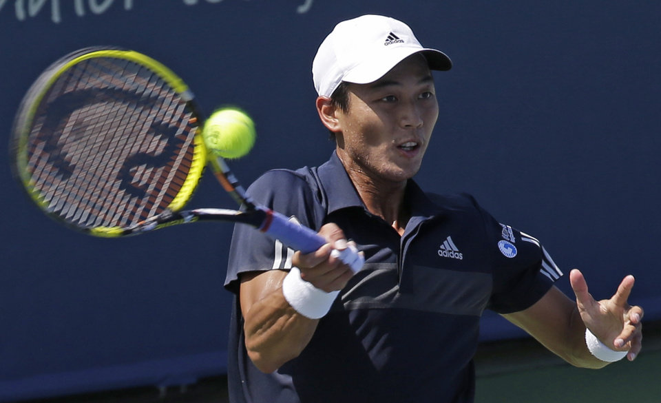 Photo - Yen-hsu Lu, from Taiwan, hits a forehand against Tomas Berdych, from Czech Republic, during a match at the Western & Southern Open tennis tournament, Wednesday, Aug. 13, 2014, in Mason, Ohio. Lu upset Berdych 3-6, 6-3, 6-4. (AP Photo/Al Behrman)