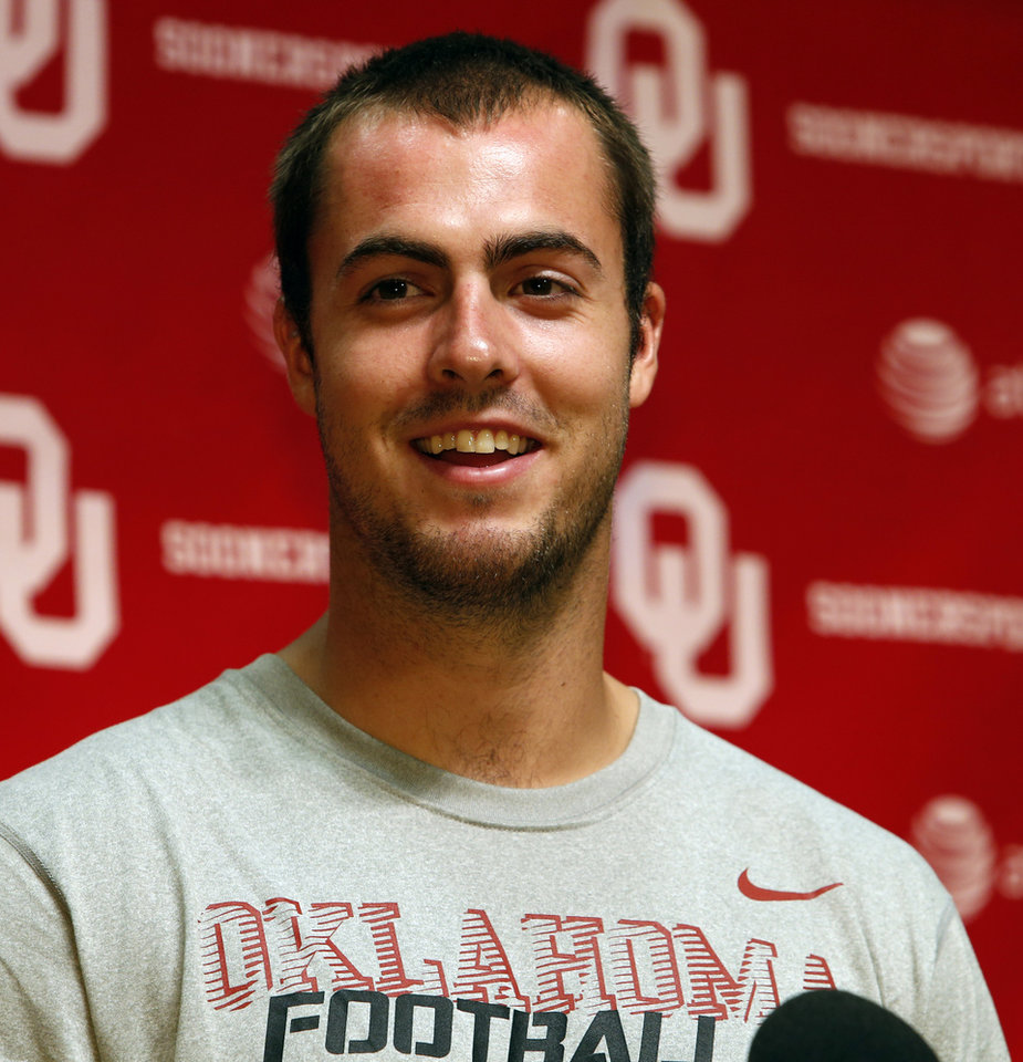 Photo - Quarterback Landry Jones (12) speaks with the media during the Meet the Sooners event at the University of Oklahoma on Saturday, Aug. 4, 2012, in Norman, Okla.  Photo by Steve Sisney, The Oklahoman