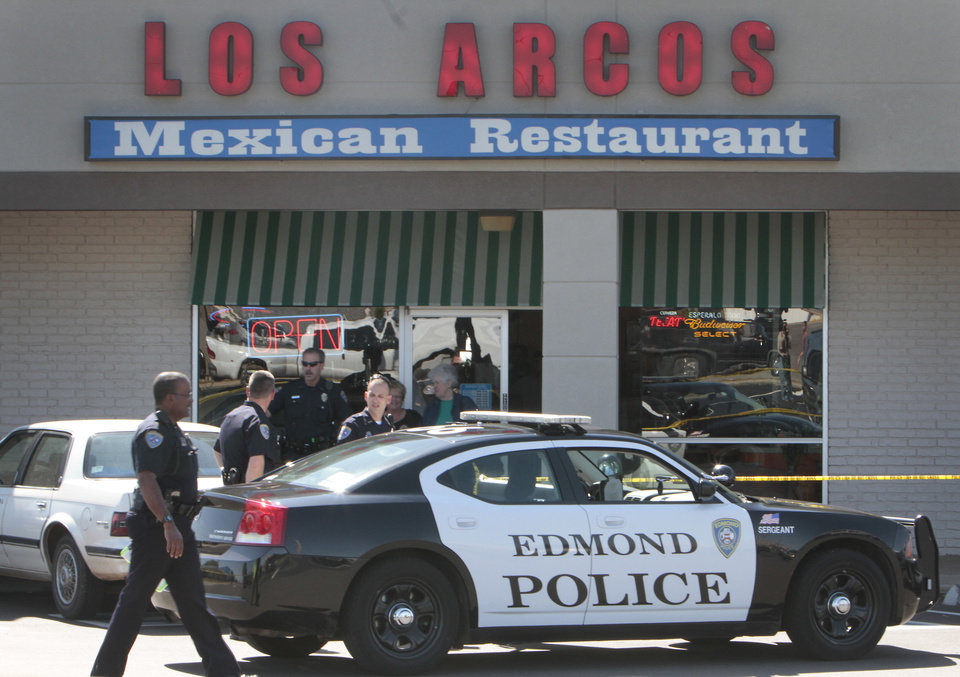 Photo - Edmond police investigate an officer-involved shooting outside a restaurant in  Bryant Square shopping mall. PHOTO BY DAVID MCDANIEL, THE OKLAHOMAN