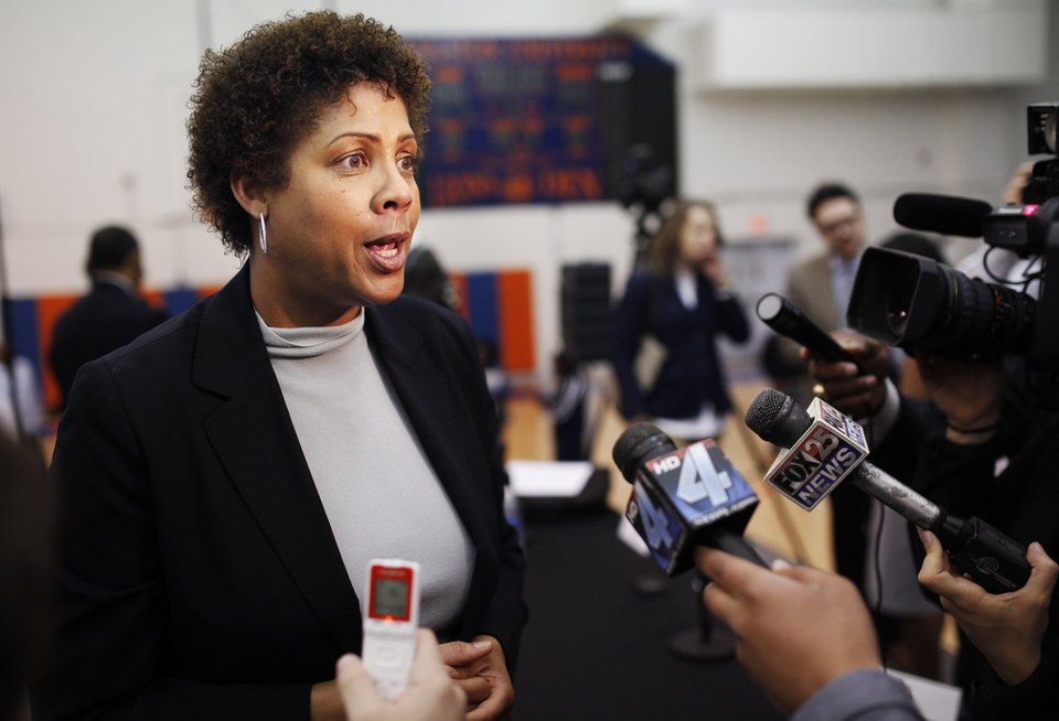 Photo - Women's basketball great Cheryl Miller takes questions from media members after a press conference where she was introduced as the head coach of Langston's women's basketball program on Tuesday, April 29, 2014 Photo by KT King, The Oklahoman