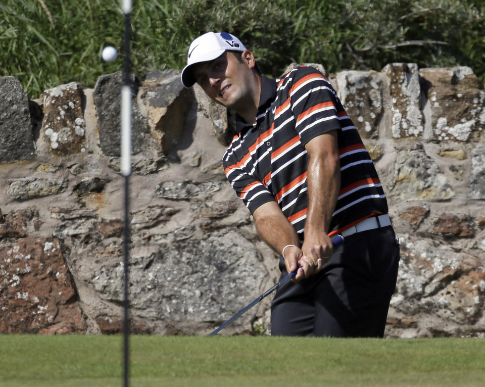 Photo - Francesco Molinari of Italy plays onto the second green during the second round of the British Open Golf Championship at Muirfield, Scotland, Friday July 19, 2013. (AP Photo/Jon Super)