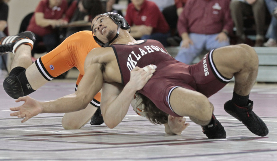 Sooner Kendric Maple escapes from Julian Feikert in the 141pound match in Bedlam wrestling as the University of Oklahoma Sooners (OU) take on the Oklahoma State Cowboys (OSU) in college NCAA wrestling at McCasland Field House on Thursday, Feb. 16, 2012, in Norman, Okla.   Photo by Steve Sisney, The Oklahoman