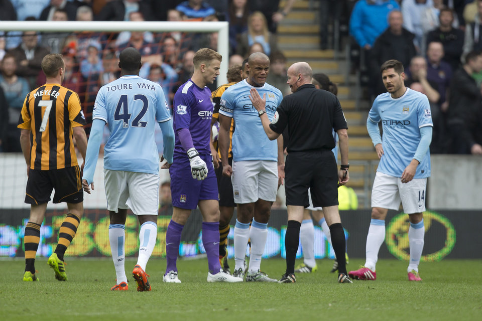 Photo - Manchester City's Vincent Kompany, centre right, remonstrates with referee Lee Mason after being sent off during his team's English Premier League soccer match against Hull City at the KC Stadium, Hull, England, Saturday March 15, 2014. (AP Photo/Jon Super)