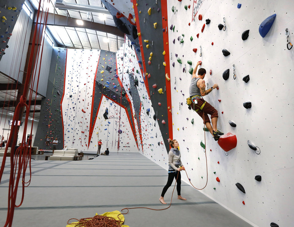 Photo - A couple using one of the climbing walls inside Threshold Climbing, located at  6024 Westlake Memorial Pkwy, on Tuesday, July 25, 2017.  Photo by Jim Beckel, The Oklahoman