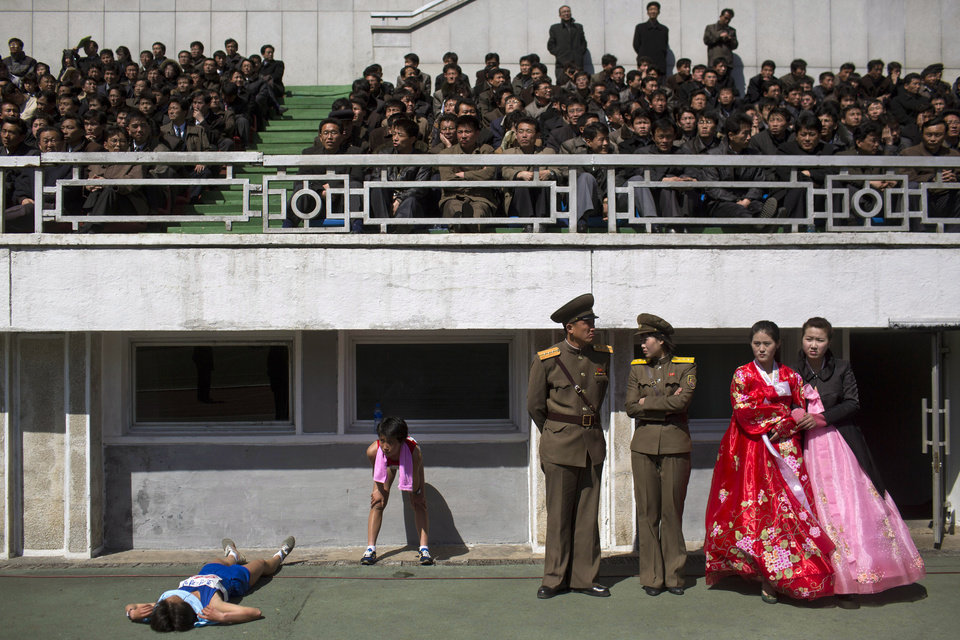 Photo - FILE - In this April 14, 2013 file photo, runners rest inside Kim Il Sung Stadium in Pyongyang as North Korea hosts the 26th Mangyongdae Prize Marathon to mark the birthday of the late leader Kim Il Sung on April 15. For the first time ever, North Korea is opening up the streets of its capital to runner-tourists for the annual Pyongyang marathon, undoubtedly one of the most exotic feathers in any runner's cap. Tourism companies say they have been inundated by requests to sign up for the April 13, 2014 event, which this year will include amateur runners from around the world. (AP Photo/David Guttenfelder, File)