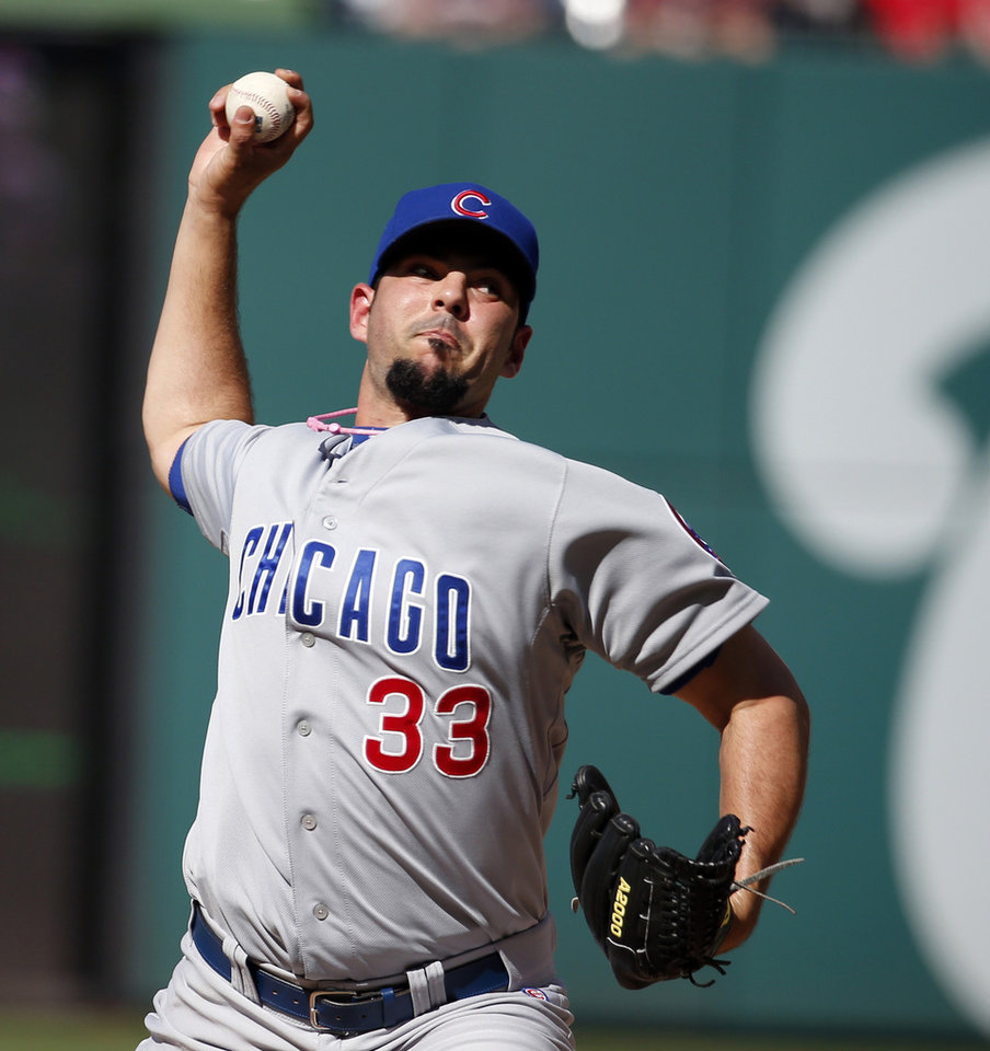 Photo - Chicago Cubs pitcher Carlos Villanueva throws during the second inning of a baseball game against the Washington Nationals at Nationals Park, Saturday, July 5, 2014, in Washington. (AP Photo/Alex Brandon)