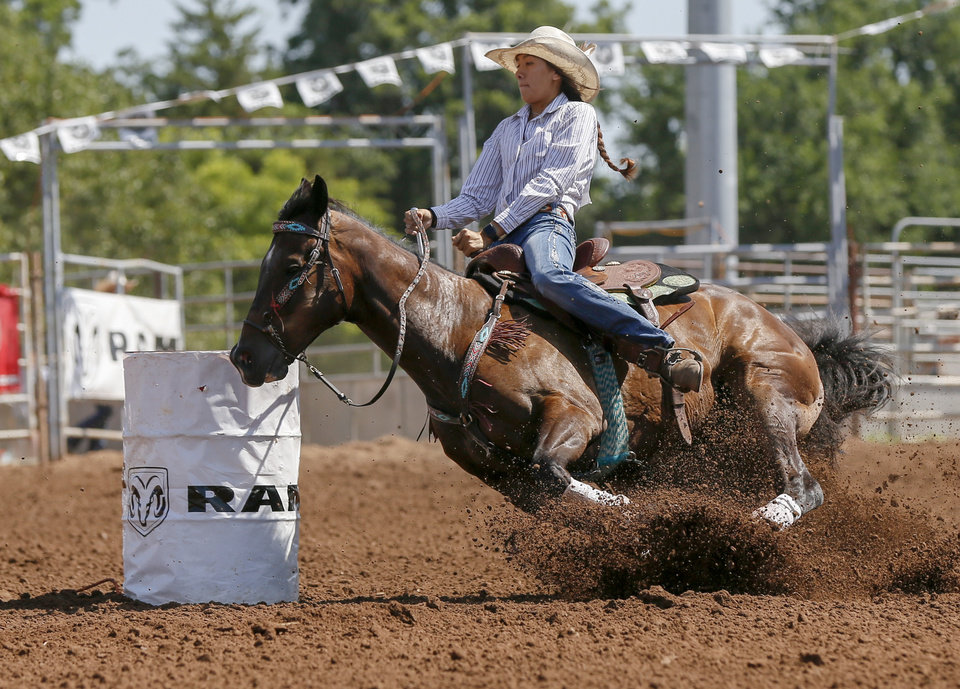 Photo - Patricia Walden of Wister, Okla., competes in barrel racing during the International Finals Youth Rodeo at the Heart of Oklahoma Exposition Center in Shawnee, Okla., Thursday morning, July 11, 2019. [Nate Billings/The Oklahoman]