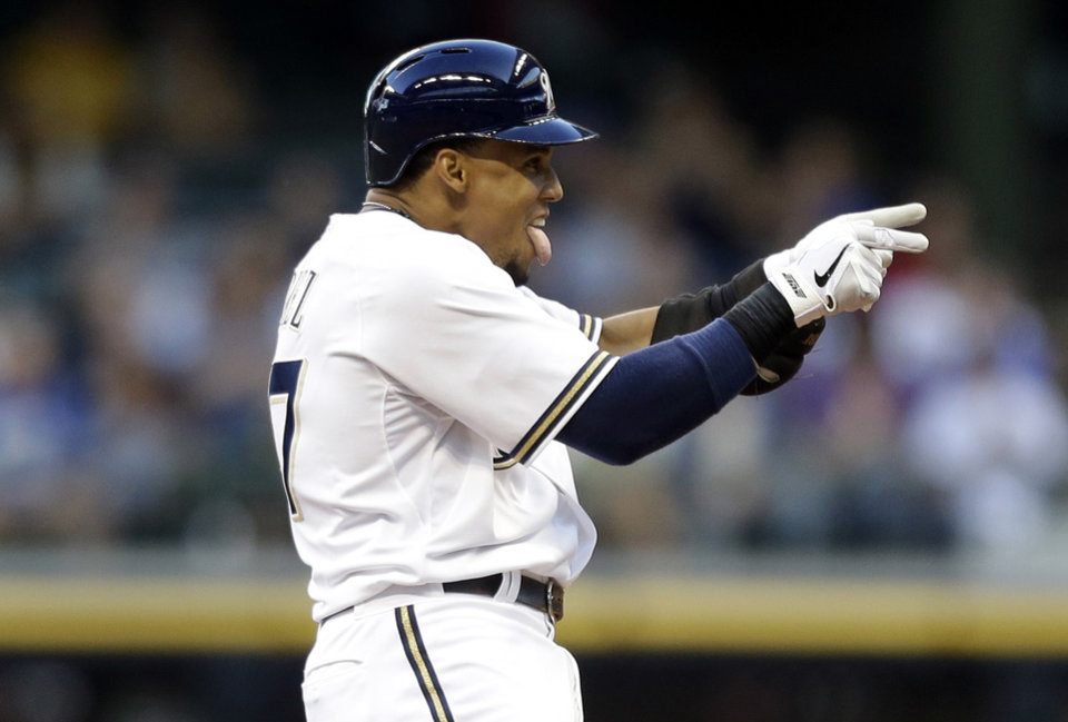Photo - Milwaukee Brewers' Carlos Gomez reacts after his double against the San Diego Padres during the second inning of a baseball game on Wednesday, July 24, 2013, in Milwaukee. (AP Photo/Jeffrey Phelps)