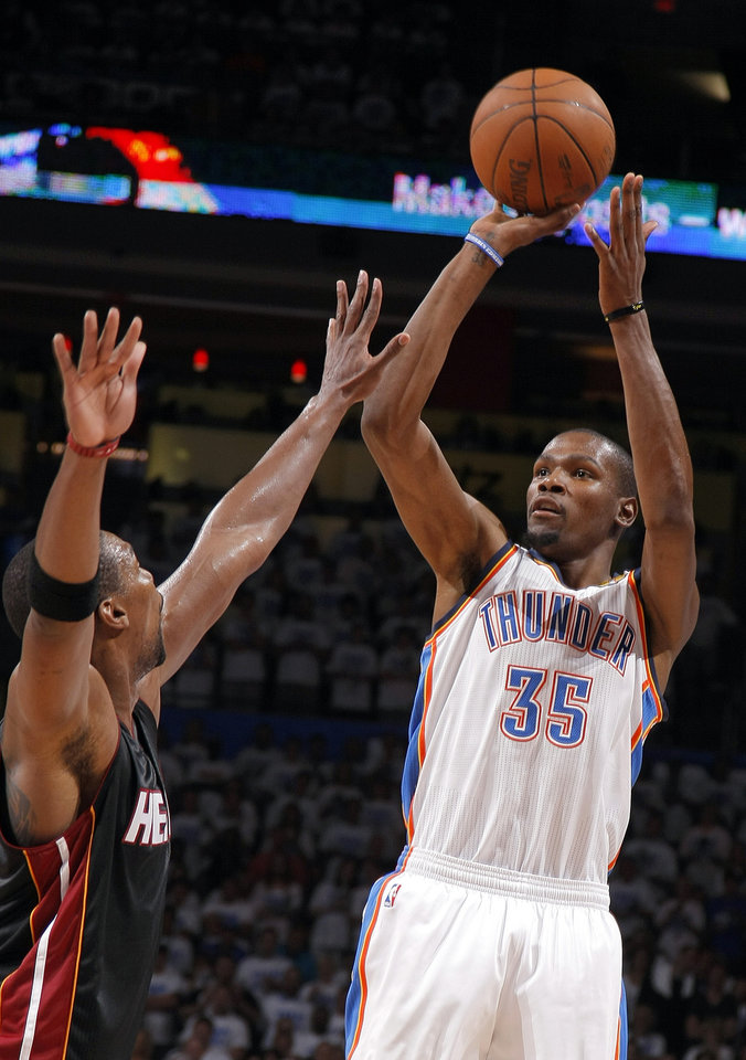 Photo - Oklahoma City's Kevin Durant (35) shoots over Miami's Chris Bosh (1) during Game 2 of the NBA Finals between the Oklahoma City Thunder and the Miami Heat at Chesapeake Energy Arena in Oklahoma City, Thursday, June 14, 2012. Photo by Sarah Phipps, The Oklahoman