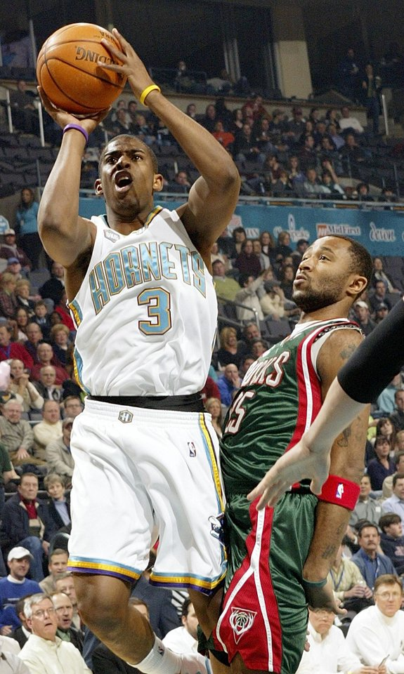Photo - Hornet Chris Paul (3) shoots the ball in front of Maurice Williams (25) of the Bucks during the NBA basketball game between the New Orleans/Oklahoma City Hornets and the Milwaukee Bucks at the Ford Center in Oklahoma City, Thursday, Feb. 8, 2007. By Nate Billings, The Oklahoman  ORG XMIT: KOD