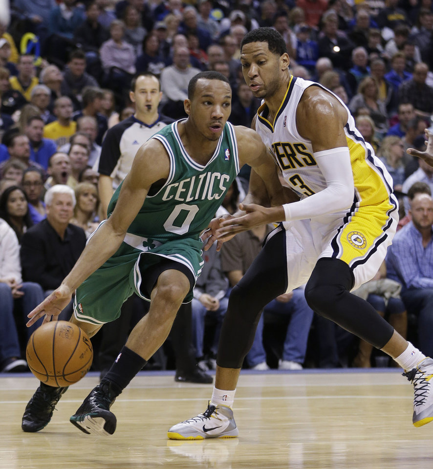 Boston Celtics' Avery Bradley (0) goes to the basket against Indiana Pacers' Danny Granger (33) during the first half of an NBA basketball game Sunday, Dec. 22, 2013, in Indianapolis. (AP Photo/Darron Cummings)