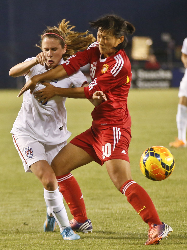 Photo - China defender Liu Shanshan, right, fouls U,S, midfielder Heather O'Reilly while cutting off her drive during the first half of an international friendly soccer match Thursday, April 10, 2014, in San Diego. (AP Photo/Lenny Ignelzi)