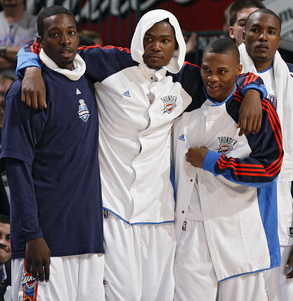 Photo - Oklahoma City's Jeff Green, Kevin Durant, Russell Westbrook and Serge Ibaka (9) looks on from the bench during the preseason NBA basketball game between the Oklahoma City Thunder and the Phoenix Suns at the Ford Center on Monday, Oct. 12, 2009, in Oklahoma City, Okla.    Photo by Chris Landsberger, The Oklahoman