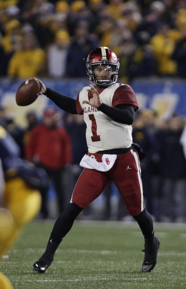 Photo -  Kyler Murray has been under pressure all season. Because of Oklahoma's defensive struggles, the Sooner quarterback has needed to make crucial plays time and again — and he has been spectacular in critical situations. [AP PHOTO]