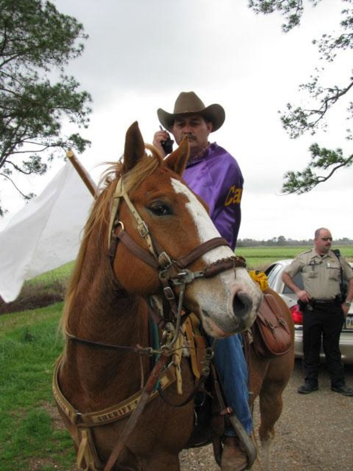 Photo - FILE - This Feb. 5, 2008 file photo shows Pat Frey, capitaine of the rural Mardi Gras atop his horse at the head of the run to direct the parade near Eunice, La. Mardi Gras includes days of live music, costume-making and an old-fashioned boucherie.  (AP Photo/Becky Bohrer, File)