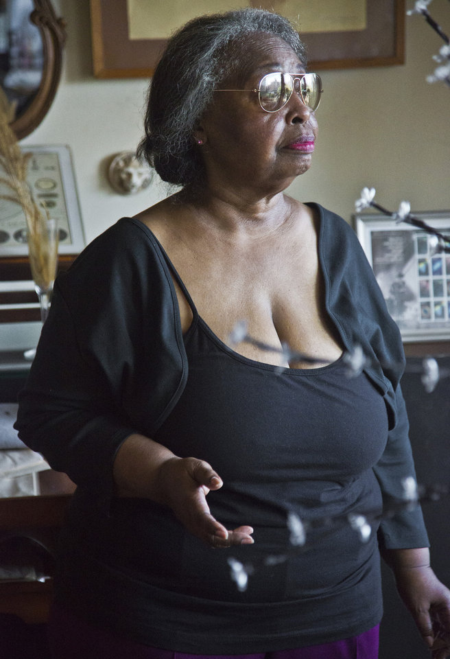 Photo - In this Aug. 5, 2014 photo Jean Green Dorsey, stands in her rent-stabilized apartment on New York City's Upper West Side. Dorsey, who has lived in the apartment since 1972, is among a growing group of New Yorkers who reside in the same building with market rate residents who denied access to amenities available to market rate residents. (AP Photo/Bebeto Matthews)