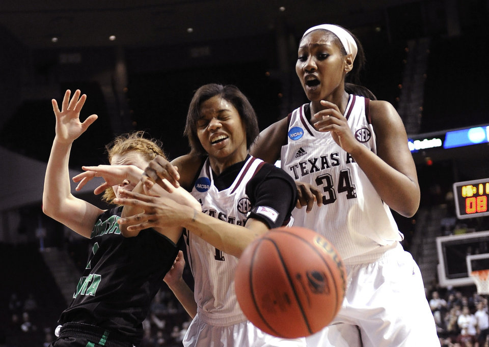Photo - North Dakota's Leah Szabia, left and Texas A&M's Courtney Williams (1) and Karla Gilbert (34) battle for the ball in the first half of a first-round NCAA women's basketball game Sunday, March 23, 2014, in College Station, Texas. The winner will face James Madison in the second round Tuesday night. (AP Photo/Pat Sullivan)
