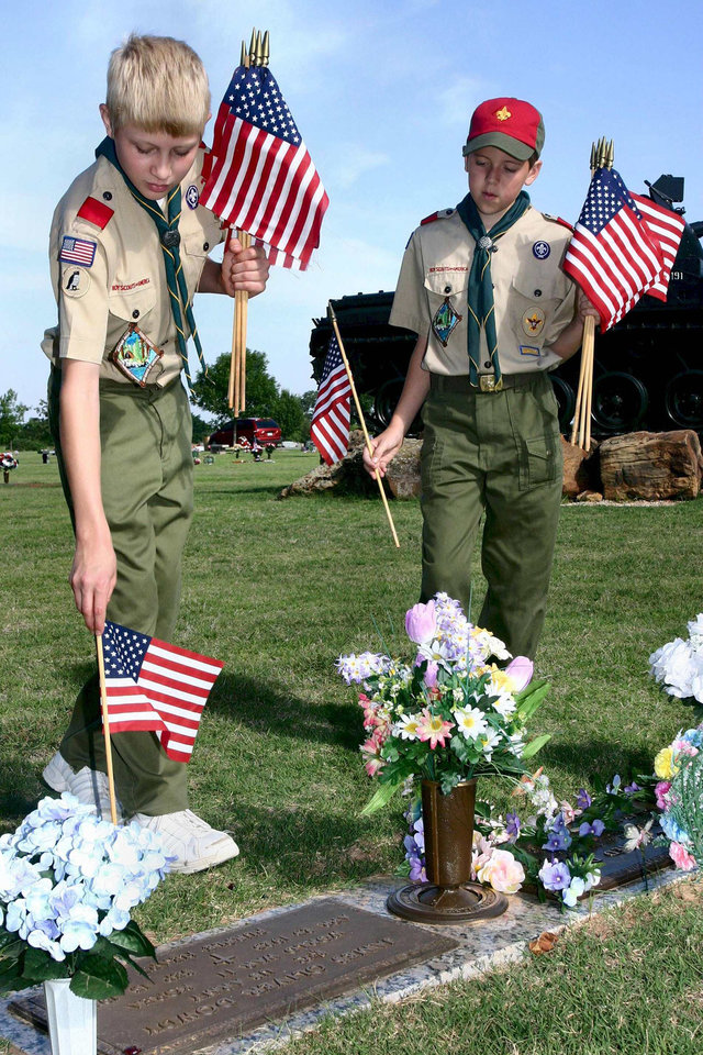 Spencer Wilterdink and Brendan Hopkins place a flag by a veteran's gravemarker during the annual Flags-in Memorial Day service project at Arlington Memorial Gardens in Midwest City.  Jason and Alex are members of Choctaw's Boy Scout Troop 275, which performs this service in conjunction with the Midwest City post of the American Legion.<br/><b>Community Photo By:</b> mark d. doiron<br/><b>Submitted By:</b> Mark, Midwest City