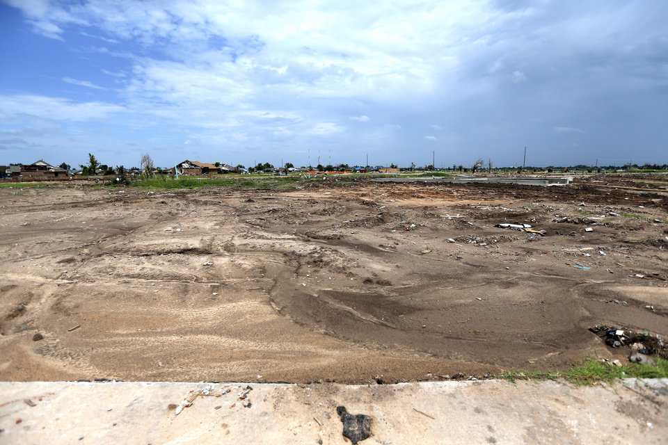 Photo - Cleared lots are pictured near SW 144 and S Robinson in Oklahoma City on Thursday. Photo by Sarah Phipps, The Oklahoman  SARAH PHIPPS