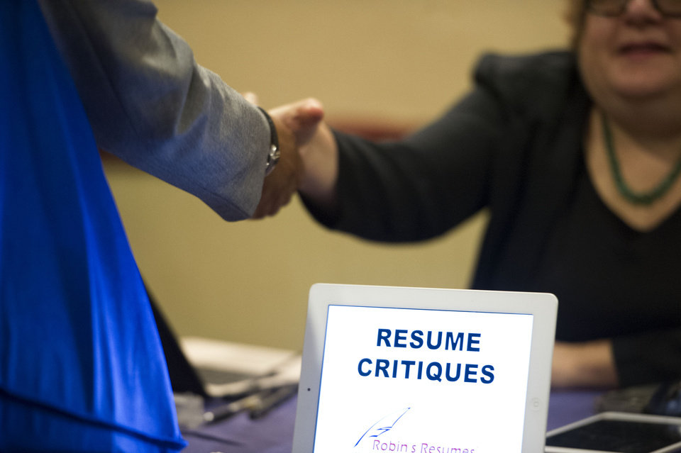 FILE -  In this Thursday, May 30, 2013, photo, a job seeker stops at a table offering resume critiques during a job fair held in Atlanta. The Labor Department releases weekly jobless claims on Thursday, Feb. 27, 2014. (AP Photo/John Amis, File)