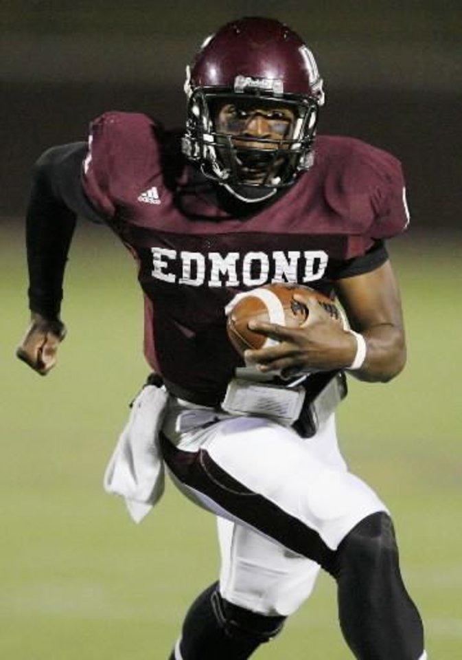 Photo - Edmond Memorial quarterback  Kameron  Doolittle (1) runs for a touchdown in the first quarter during the Class 6A high school football playoff game between Mustang and Edmond Memorial at Wantland Stadium in Edmond, Okla., Friday, Nov. 13, 2009. Photo by Nate Billings