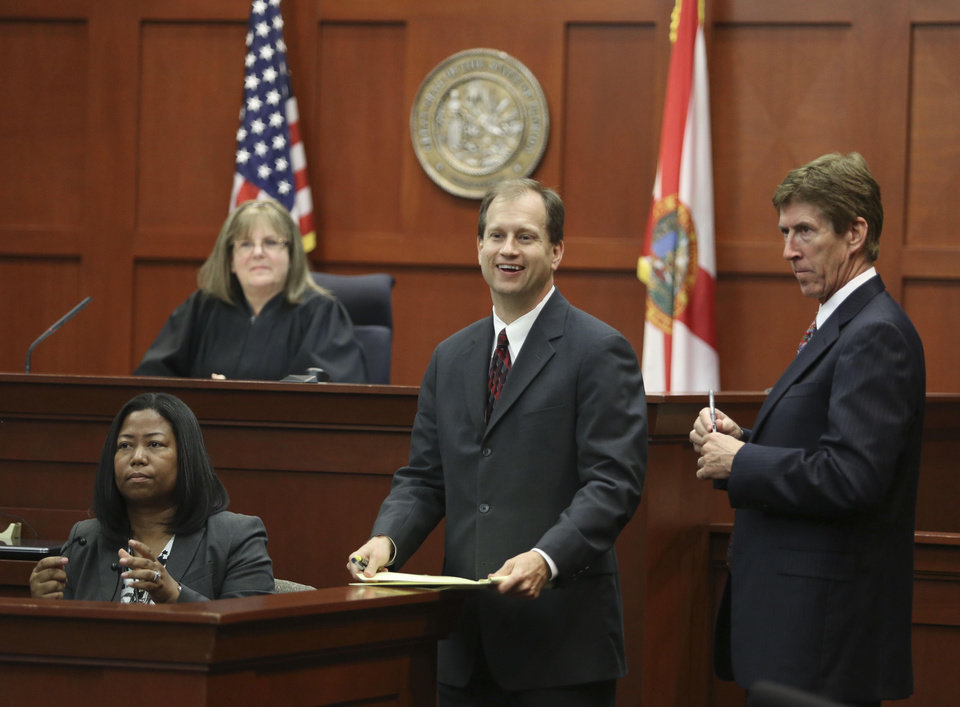 Assistant state attorney Richard Mantei, center, and defense attorney Mark O'Mara, right, review transcripts with the court reporter concerning a question by the jury during deliberations in George Zimmerman's trial in Seminole circuit court in Sanford, Fla. Saturday, July 13, 2013. Zimmerman has been charged with the 2012 shooting death of Trayvon Martin.(AP Photo/Orlando Sentinel, Gary W. Green, Pool) ORG XMIT: FLJR232