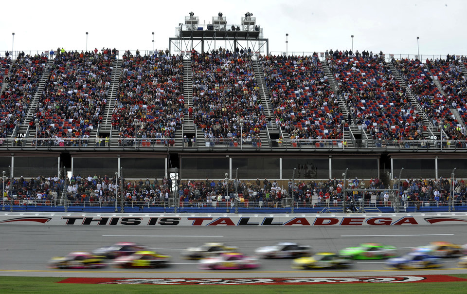 A pack of cars race through the tri-oval during the NASCAR Sprint Cup auto race at Talladega Superspeedway in Talladega, Ala., Sunday, Oct. 7, 2012. (AP Photo/Rainier Ehrhardt)