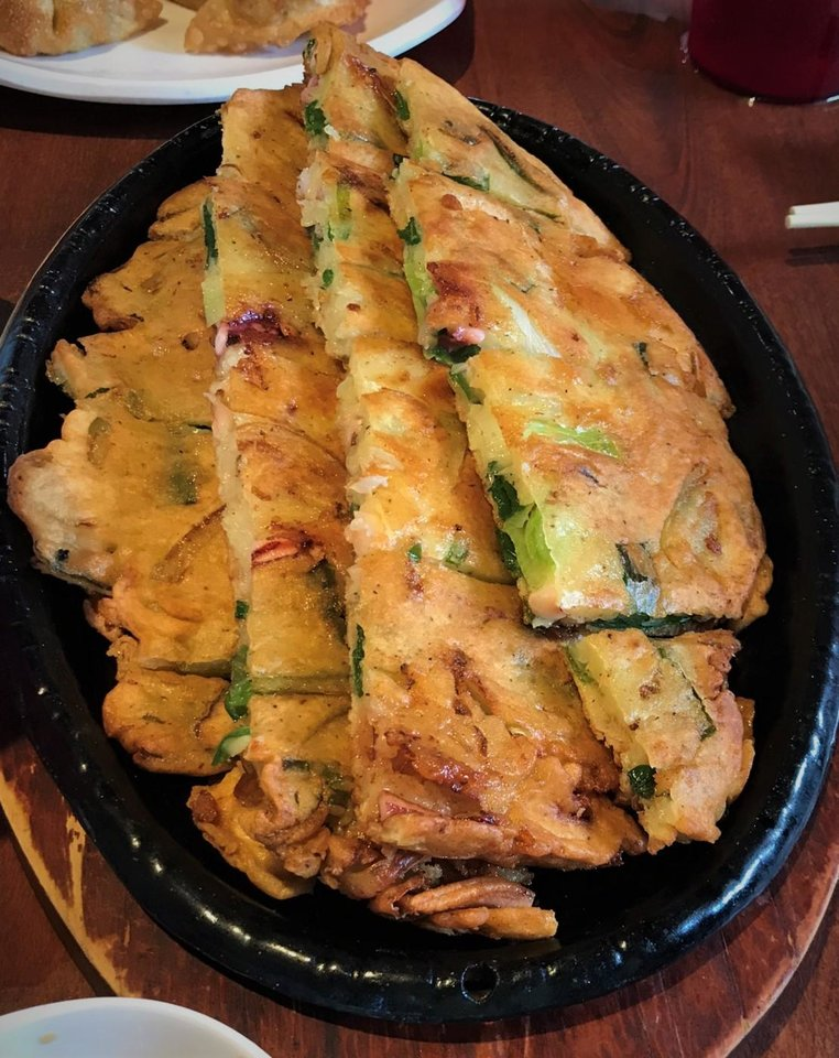 Photo - Seafood pajeon from Taste of Korea in Oklahoma City. [Dave Cathey/The Oklahoman]