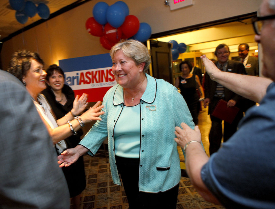 Photo - Lt. Gov. Jari Askins is greeted by supporters during a watch party for the Democratic side of the gubernatorial primary in Oklahoma City, Tuesday, July 27, 2010.  Photo by Bryan Terry, The Oklahoman