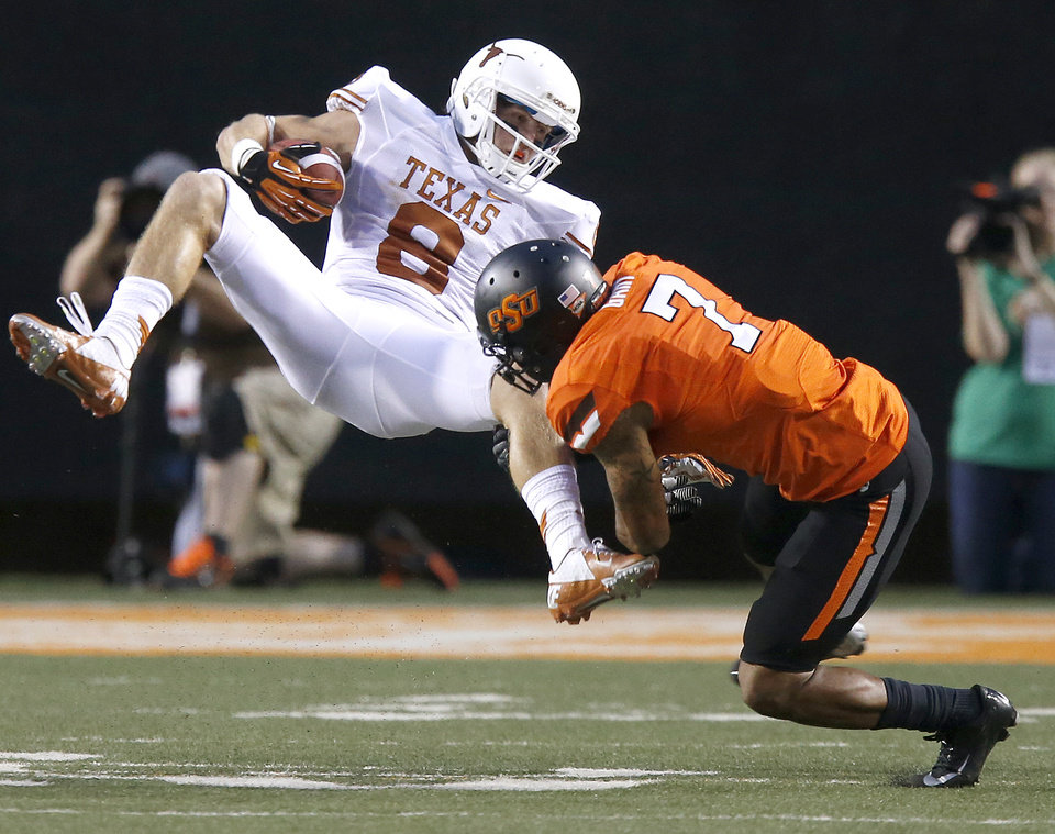 Oklahoma State's Shamiel Gary (7) brings down Texas' Jaxon Shipley (8) during a college football game between Oklahoma State University (OSU) and the University of Texas (UT) at Boone Pickens Stadium in Stillwater, Okla., Saturday, Sept. 29, 2012. Photo by Bryan Terry, The Oklahoman