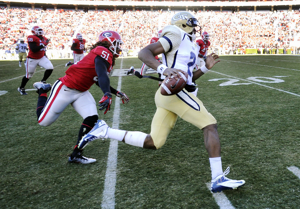 Georgia Tech quarterback Vad Lee (2) runs up the sideline as Georgia linebacker Ramik Wilson (51) pursues during the second half of an NCAA college football game, Saturday, Nov. 24, 2012, in Athens, Ga. Georgia won 42-10. (AP Photo/John Amis)
