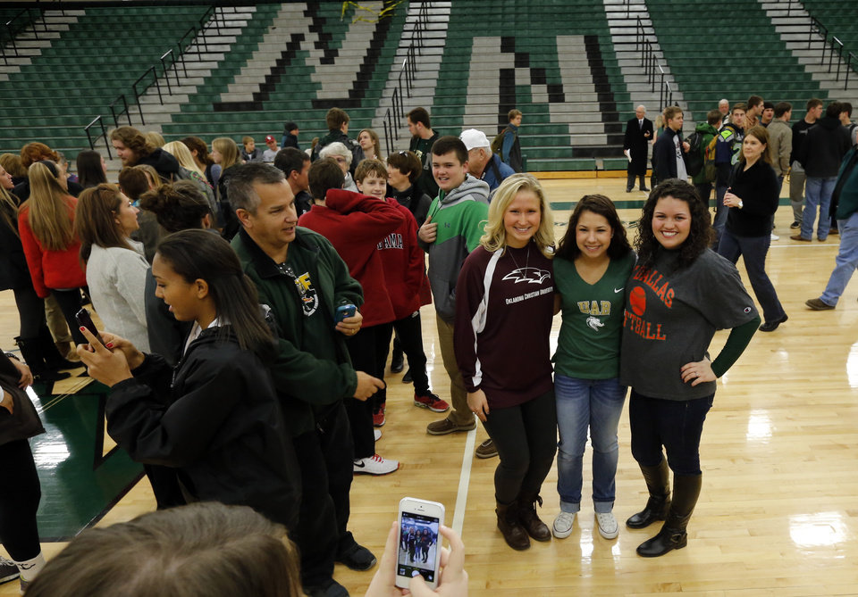 Athletes Mackenzie Marquardt, Bri Kuestersteffen and Michaela Smith pose for a photograph at signing day ceremonies at Norman North High School on Wednesday, Feb. 5, 2014 in Norman, Okla.  Marquardt and Kuestersteffen will play soccer for Oklahoma Christian and Alabama Brimingham respectively, and Smith will play softball for University of Texas, Dallas.  Photo by Steve Sisney, The Oklahoman