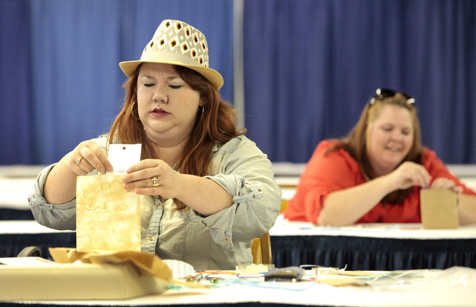 Photo - Lecye Doolen-Lippoldt, from Sasokwa, and Jennifer Howeth, from Newcastle,compete in the Live Scrapbook Challenge in the Creative Arts Building at the Oklahoma State Fair , Friday, September 13, 2013.  This was at 11:00 a.m. Photo by David McDaniel, The Oklahoman
