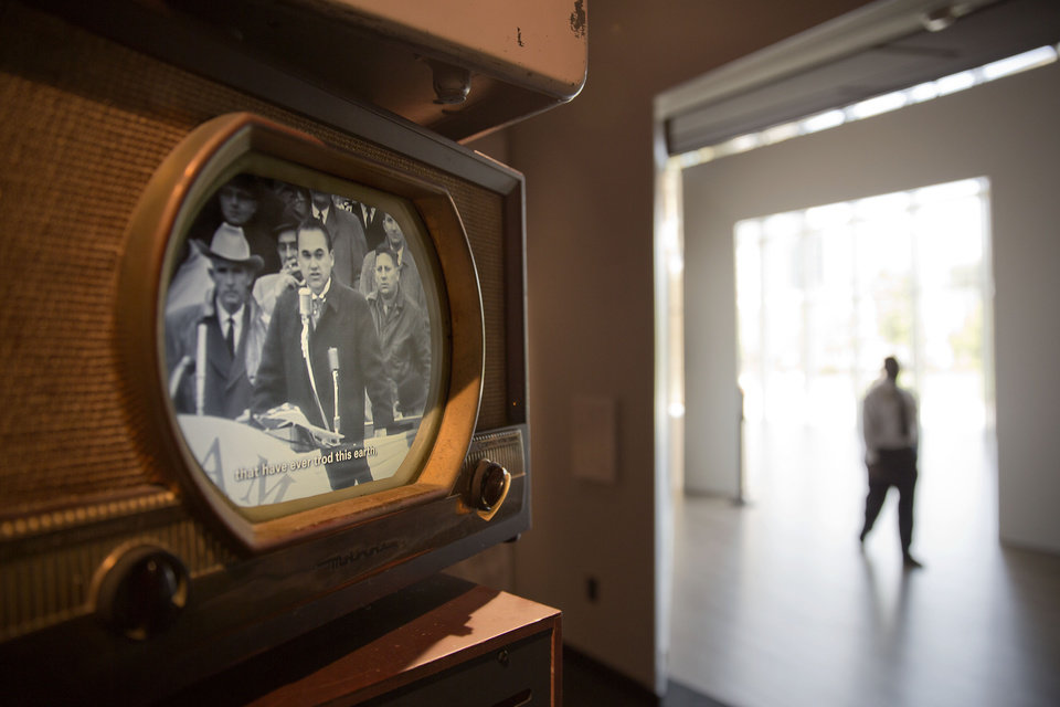 Photo - In this June 16, 2014 photo, a vintage television shows a clip of former Alabama Gov. George Wallace speaking in favor of segregation as part of an exhibit at the newly built National Center for Civil and Human Rights in Atlanta. The new museum about the history of civil rights opens next week in Atlanta, the city where Martin Luther King Jr. was based. But the National Center for Civil and Human Rights also explores other human rights struggles, from women's rights and LGBT issues to immigration and child labor. The museum devotes separate galleries to modern human rights issues and the U.S. civil rights movement of the 1950s and '60s, but also demonstrates how the two struggles are related. Visitors learn history through interactive exhibits and stories of real people. (AP Photo/David Goldman)