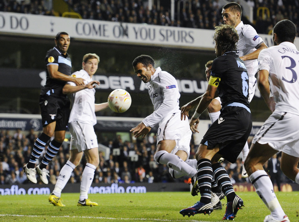 Photo -   Tottenham Hotspur's Sandro, center, tries unsuccessfully to score against Lazio during a Europa League Group J soccer match at White Hart Lane ground in London, Thursday, Sept. 20, 2012. (AP Photo/Tom Hevezi)