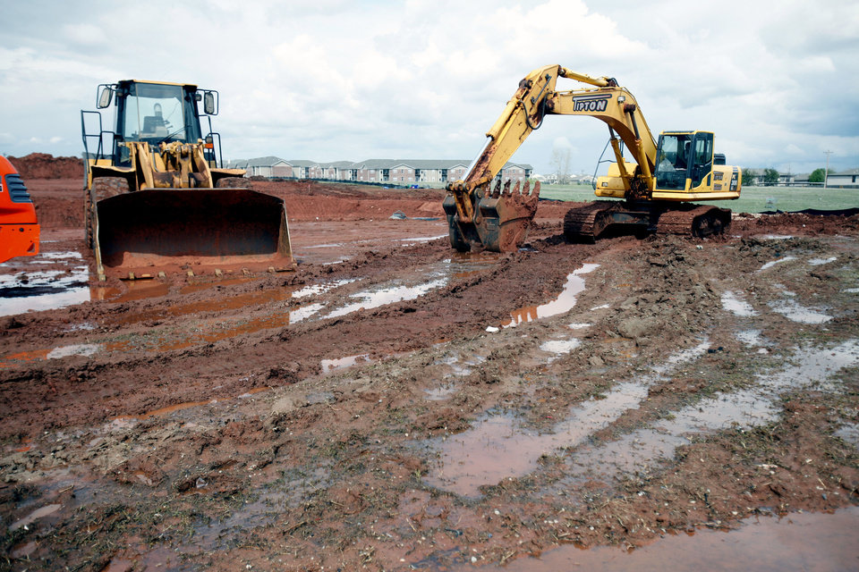 Photo - Heavy rains earlier this week appear to have slowed work on the Dick's Sporting Goods site northeast of N Pennsylvania and Memorial Road. Photo by PAUL HELLSTERN, The Oklahoman