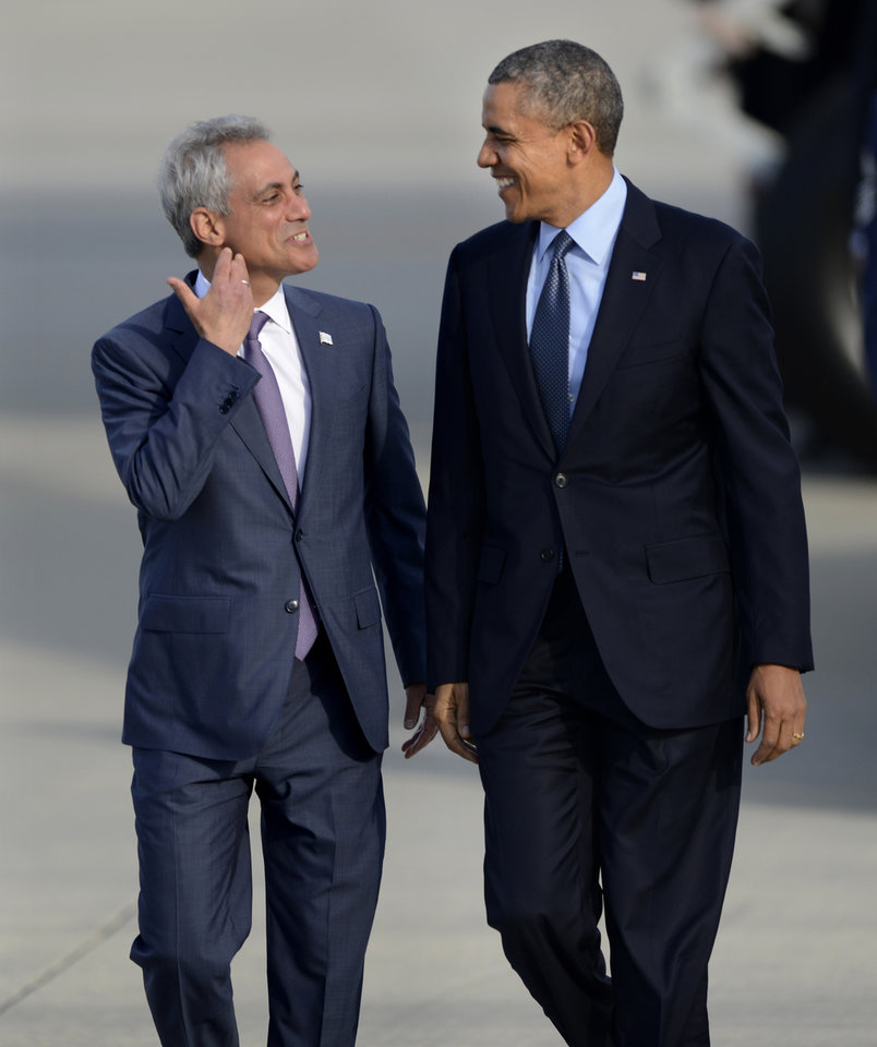 Photo - President Barack Obama right, talks with Chicago Mayor Rahm Emanuel left, as he walks off Air Force One after arriving at O'Hare International Airport in Chicago, Thursday, May 22, 2014. (AP Photo/Paul Beaty)
