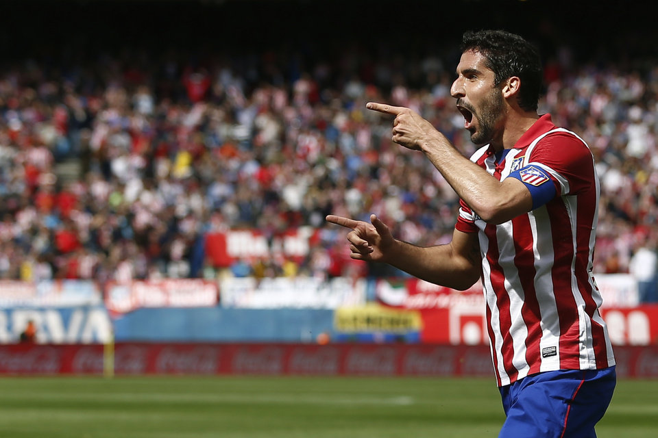Photo - Atletico's Raul Garcia celebrates his goal during a Spanish La Liga soccer match between Atletico Madrid and  Villarreal at the Vicente Calderon stadium in Madrid, Spain, Saturday, April 5, 2014. (AP Photo/Andres Kudacki)