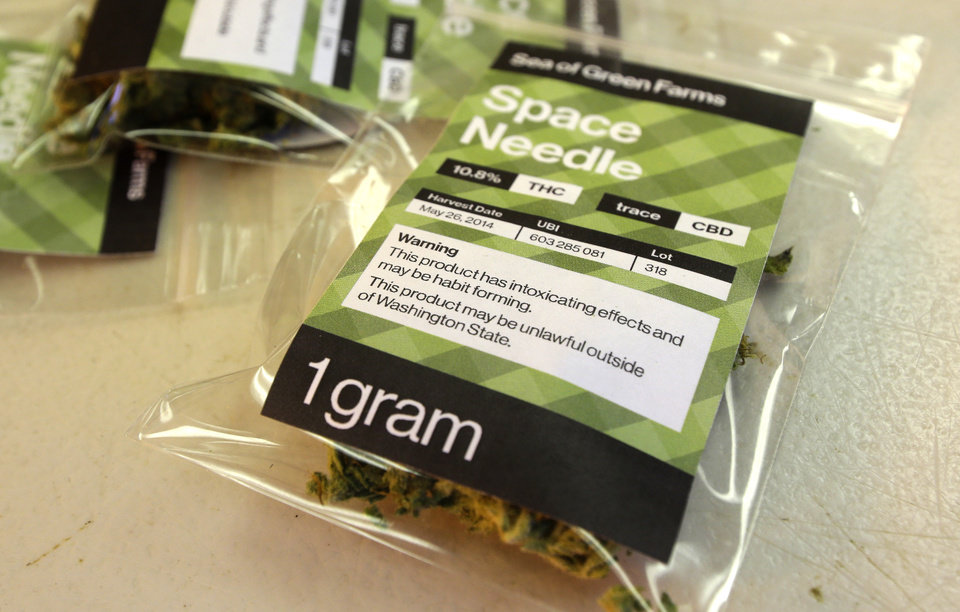 Photo - This July 1, 2014, photo shows a one-gram packet of a variety of recreational marijuana named