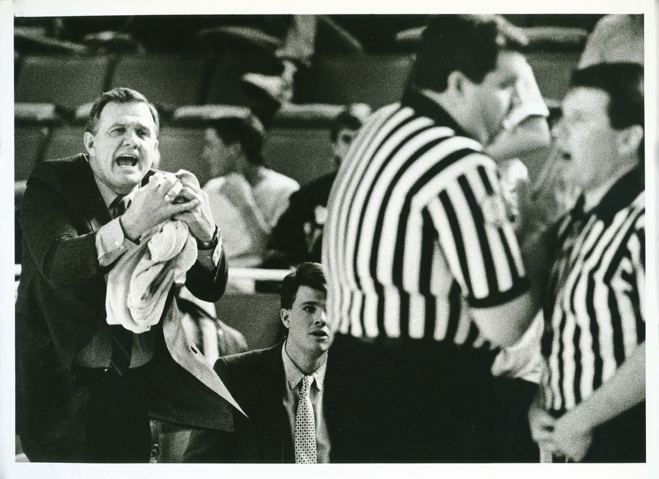 Carl Albert coach Dub Raper makes a plea to the officials, who are holding a mid-court conference in Friday's 4A semifinal game. STAFF PHOTO BY JIM BECKEL THE OKLAHOMAN (Photo taken March 10, 1989) (Photo published March 11, 1989 in The Daily Oklahoman)