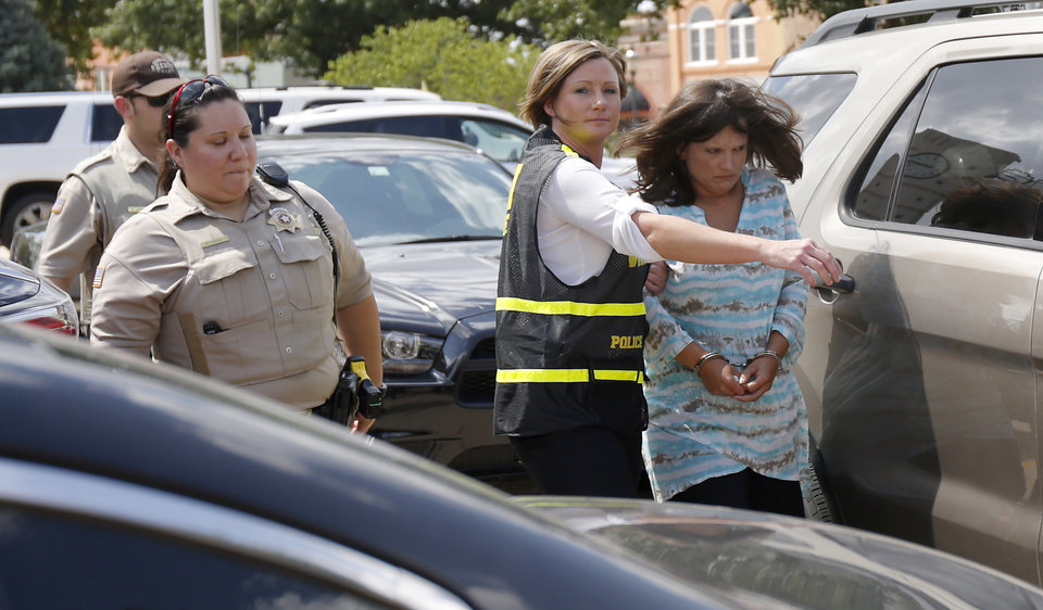 Photo - Vanisa Jo Gay is led away from the Garfield County Courthouse in Enid, Okla., Tuesday, July 25, 2017, after being indicted in connection with the death of an inmate. Photo by Bryan Terry, The Oklahoman