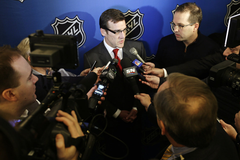 Washington Capitals vice president and general manager George McPhee speaks to reporters, Wednesday, Jan. 9, 2013, in New York. NHL owners ratified the tentative labor deal on Wednesday. All that now remains is player approval to finally start the hockey season. (AP Photo/Frank Franklin II)