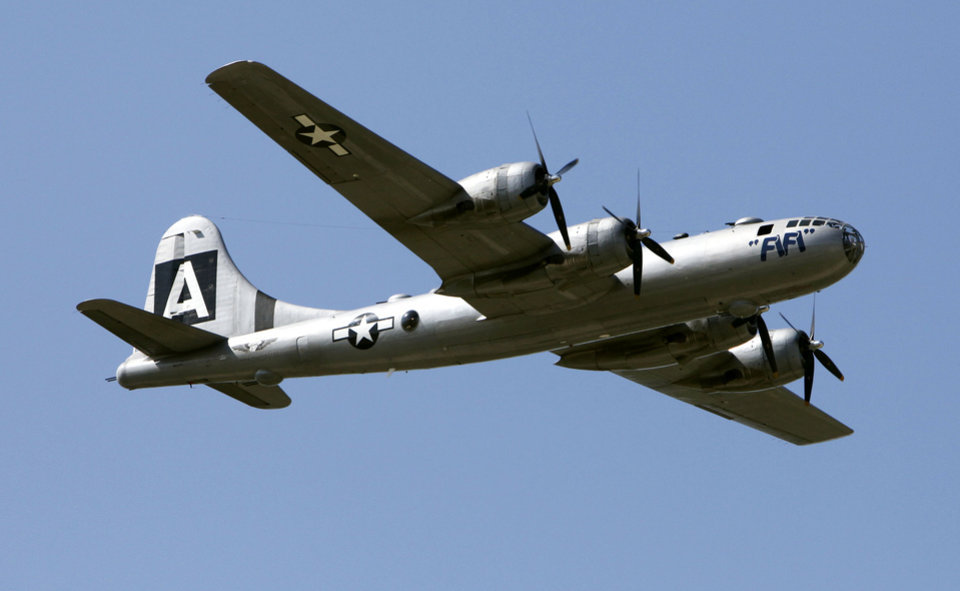 Photo - The last airworthy B-29 Superfortress flies into Wiley Post Airport in Oklahoma City, OK, Tuesday, October 2, 2012. It will be on exhibit for six days at Wiley Post Airport.  By Paul Hellstern, The Oklahoman
