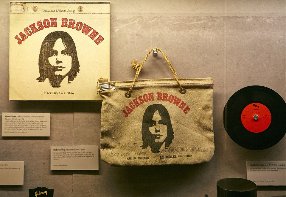 Photo - In this Friday, May. 9, 2014, photo, Songwriter Jackson Browne's classic L.P. cover, and the original radiator bag printed with the album cover art from Jackson Browne's debut album to promote its release, are displayed at the Grammy Museum exhibit