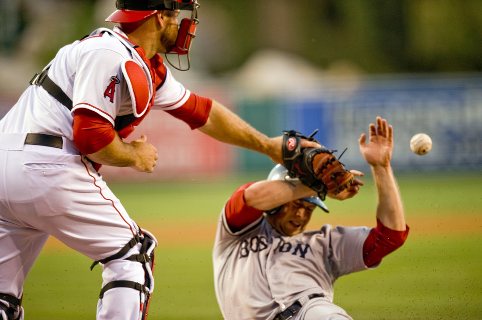Boston Red Sox's Daniel Nava beats the throw home to Los Angeles Angels catcher Chris Iannetta to score in the second inning of a baseball game, Saturday, July 6, 2013, in Anaheim, Calif. (AP Photo/The Orange County Register, Paul Rodriguez)