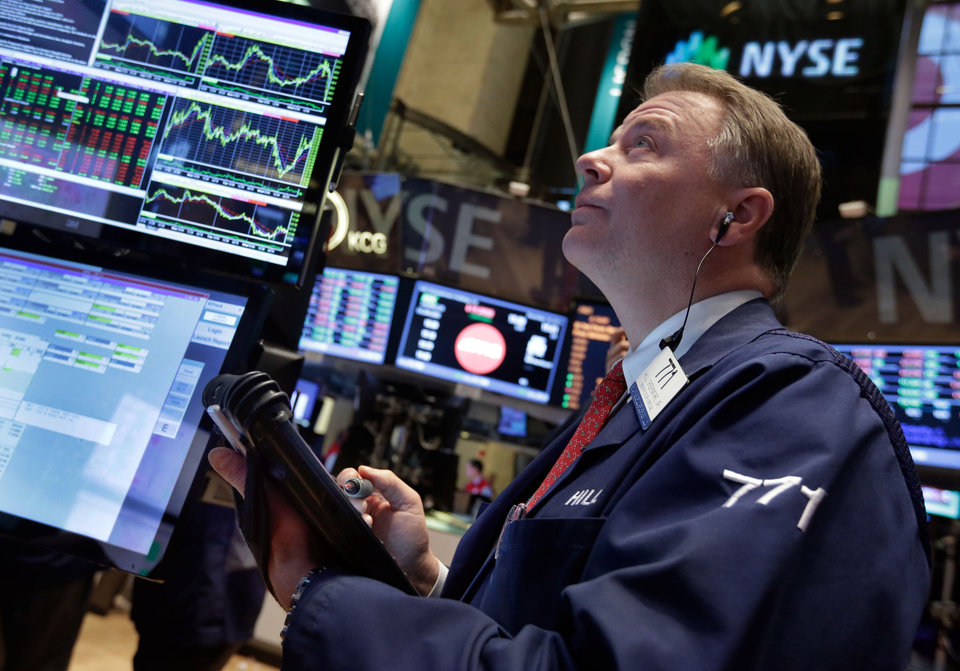 Photo - Trader F. Hill Creekmore works on the floor of the New York Stock Exchange Wednesday, Dec. 18, 2013.  Stocks surged after the Federal Reserve decided the U.S. economy was strong enough for it to reduce its stimulus efforts. (AP Photo/Richard Drew)
