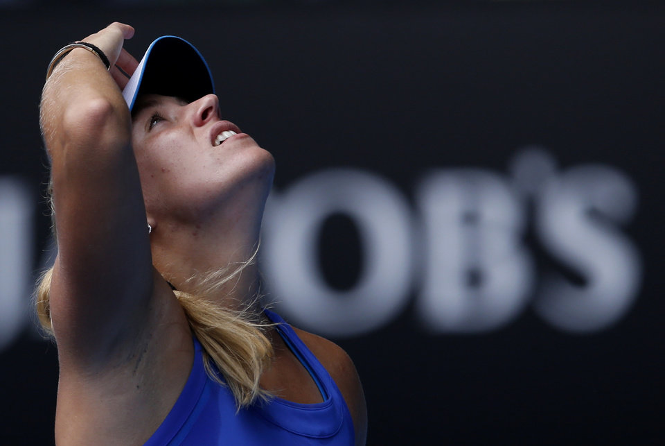 Photo - Angelique Kerber of Germany reacts between points as she plays  Flavia Pennetta of Italy during their fourth round match at the Australian Open tennis championship in Melbourne, Australia, Sunday, Jan. 19, 2014.(AP Photo/Eugene Hoshiko)