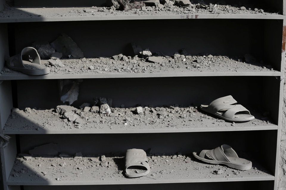 Photo - Shelves for the shoes of Muslim worshippers are seen damaged at the Ameen mosque in Gaza City, northern Gaza Strip, destroyed by an Israeli strike, Tuesday, July 29, 2014. Early Tuesday, Israel warplanes struck a series of targets in Gaza City, including the top Hamas leader in Gaza, Ismail Haniyeh's house and government offices, while Gaza's border area with Israel was hit by heavy tank shelling. (AP Photo/Lefteris Pitarakis)