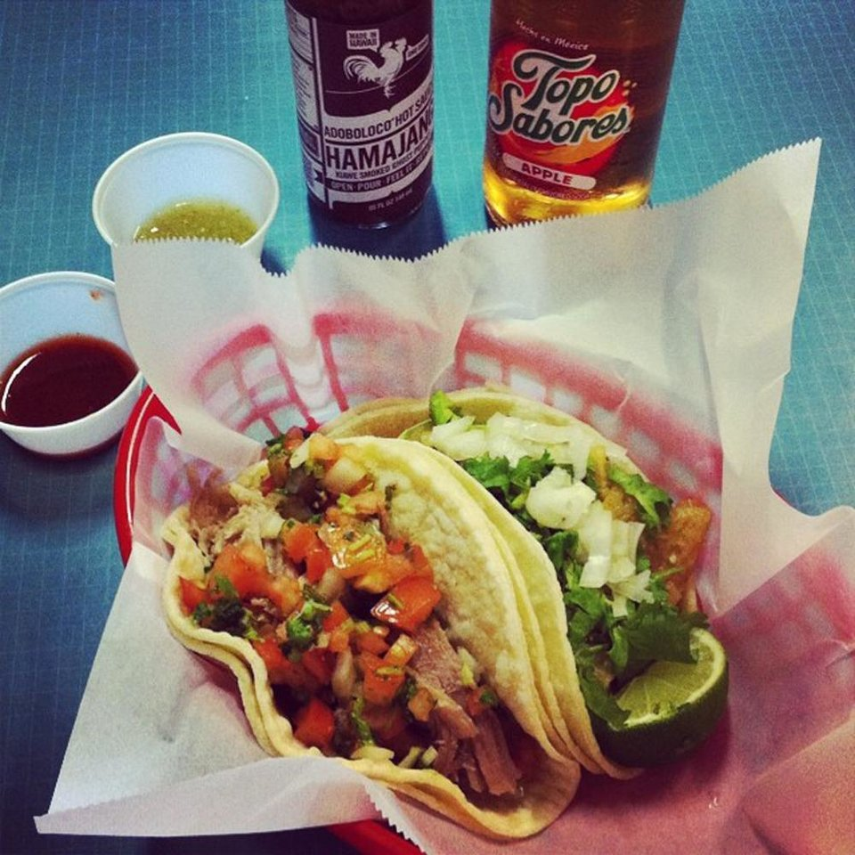 Photo - This undated photo provided by Tim Fernandes-Parsons and posted in June 2014 to the Instagram account of his company, Adoboloco, shows his product with tacos at La Tienda Del Sol in Kihei, Hawaii. (AP Photo/Courtesy Tim Fernandes-Parsons)